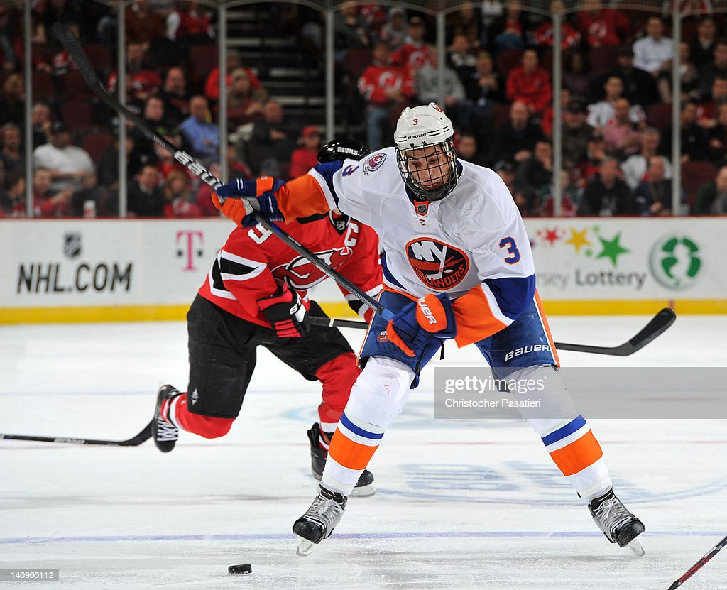 <a gi-track='captionPersonalityLinkClicked' href=/galleries/search?phrase=Travis+Hamonic&family=editorial&specificpeople=4605791 ng-click='$event.stopPropagation()'>Travis Hamonic</a> #3 of the New York Islanders takes a shot on goal during the third period against the New Jersey Devils on March 8, 2012 at the Prudential Center in Newark, New Jersey.
