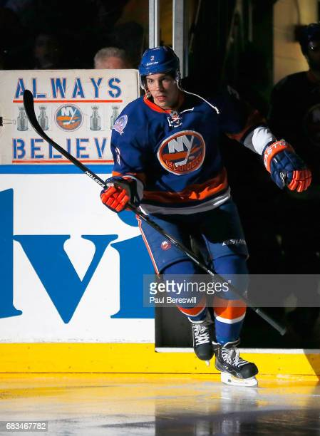 Travis Hamonic of the New York Islanders takes the ice before the game against the Tampa Bay Lightning at Nassau Veterans Memorial Coliseum on...