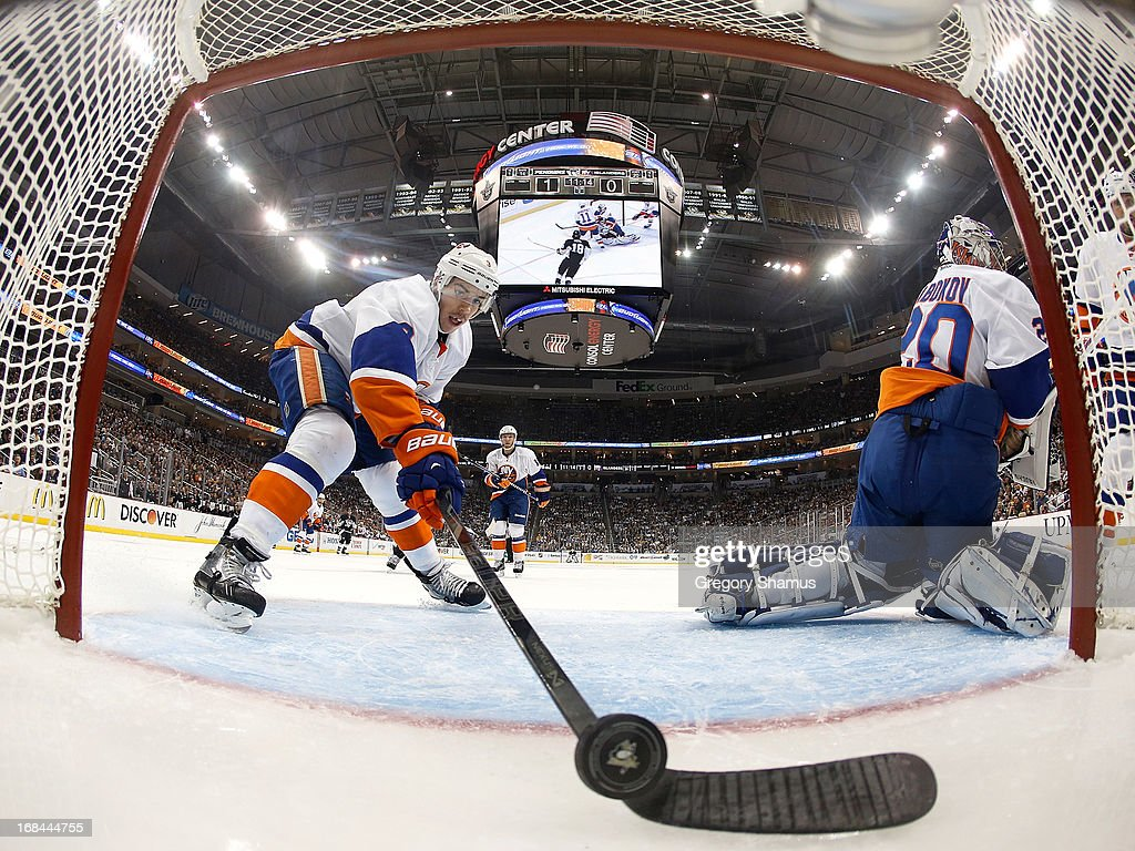 <a gi-track='captionPersonalityLinkClicked' href=/galleries/search?phrase=Travis+Hamonic&family=editorial&specificpeople=4605791 ng-click='$event.stopPropagation()'>Travis Hamonic</a> #3 of the New York Islanders tries to stop the puck on a goal by Douglas Murray #3 of the Pittsburgh Penguins in Game Five of the Eastern Conference Quarterfinals during the 2013 NHL Stanley Cup Playoffs at Consol Energy Center on May 9, 2013 in Pittsburgh, Pennsylvania.