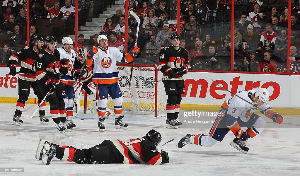 <a gi-track='captionPersonalityLinkClicked' href=/galleries/search?phrase=Travis+Hamonic&family=editorial&specificpeople=4605791 ng-click='$event.stopPropagation()'>Travis Hamonic</a> #3 the New York Islanders pumps his fist to celebrate his goal against Andre Benoit #61, Chris Phillips #4, <a gi-track='captionPersonalityLinkClicked' href=/galleries/search?phrase=Mika+Zibanejad&family=editorial&specificpeople=7832310 ng-click='$event.stopPropagation()'>Mika Zibanejad</a> #93 and <a gi-track='captionPersonalityLinkClicked' href=/galleries/search?phrase=Colin+Greening&family=editorial&specificpeople=7183741 ng-click='$event.stopPropagation()'>Colin Greening</a> #14 of the Ottawa Senators with teammates <a gi-track='captionPersonalityLinkClicked' href=/galleries/search?phrase=Kyle+Okposo&family=editorial&specificpeople=540469 ng-click='$event.stopPropagation()'>Kyle Okposo</a> #21 and <a gi-track='captionPersonalityLinkClicked' href=/galleries/search?phrase=Michael+Grabner&family=editorial&specificpeople=537955 ng-click='$event.stopPropagation()'>Michael Grabner</a> #40 on February 19, 2013 at Scotiabank Place in Ottawa, Ontario, Canada.