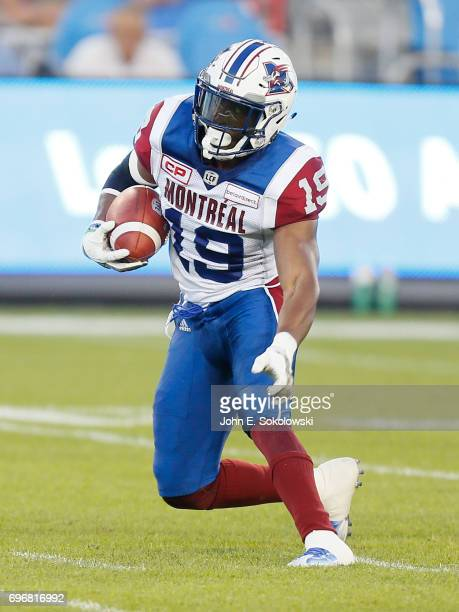Travis Hawkins of the Montreal Alouettes returns an interception against the Toronto Argonauts during a CFL preseason game at BMO field on June 8...