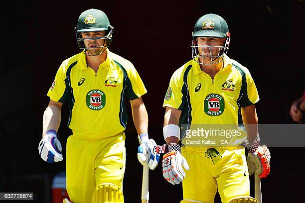 Travis Head and David Warner of Australia walk out to open the batting during game five of the One Day International series between Australia and...