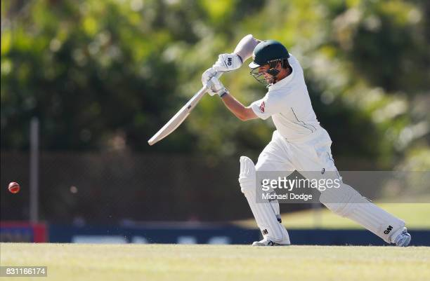 Travis Head bats during day one of the Australian Test cricket intersquad match at Marrara Cricket Ground on August 14 2017 in Darwin Australia