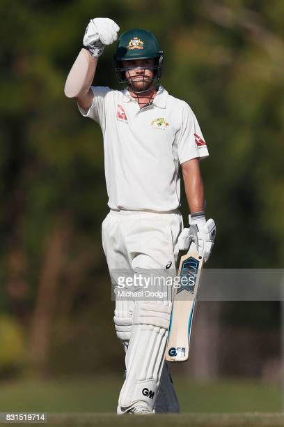 Travis Head celebrates his century during day two of the Australian Test cricket intersquad match at Marrara Cricket Ground on August 15 2017 in...