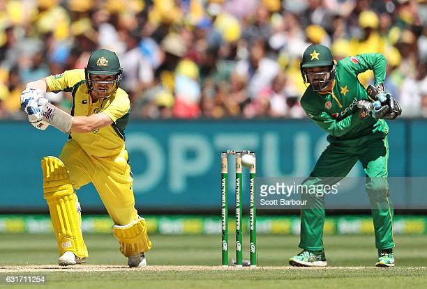 Travis Head of Australia bats as wicketkeeper Mohammad Rizwan of Pakistan looks on during game two of the One Day International series between...