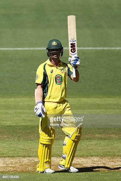 Travis Head of Australia celebrates after reaching 50 runs during game five of the One Day International series between Australia and Pakistan at...