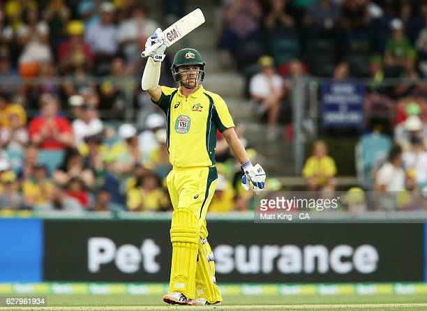 Travis Head of Australia celebrates and acknowledges the crowd after scoring a half century during game two of the One Day International series...