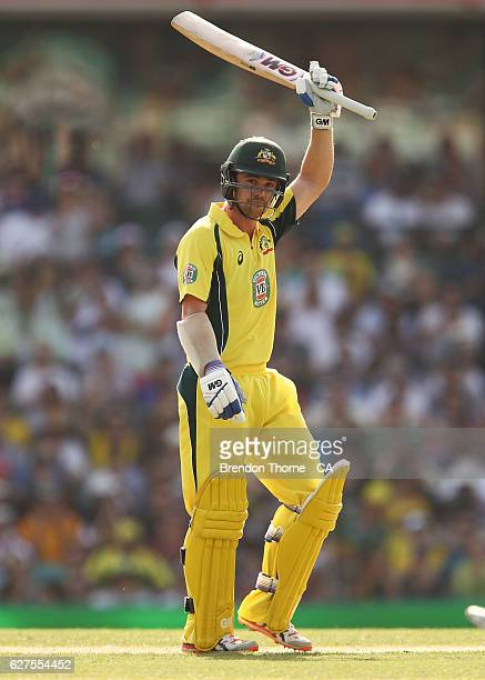 Travis Head of Australia celebrates scoring his half century during game one of the One Day International series between Australia and New Zealand at...