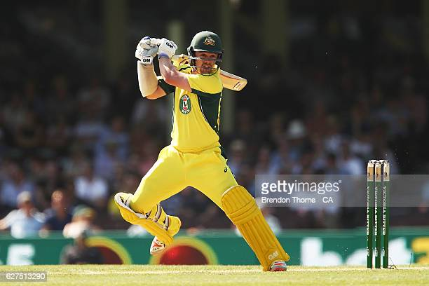 Travis Head of Australia plays a cut shot during game one of the One Day International series between Australia and New Zealand at Sydney Cricket...