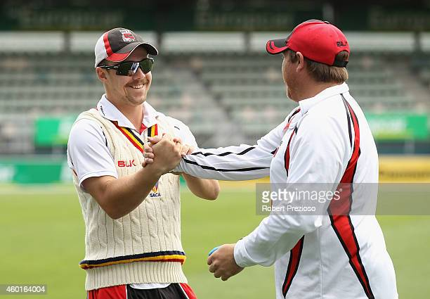 Travis Head of South Australia and Mark Cosgrove of South Australia share a joke during day one of the Sheffield Shield match between Tasmania and...