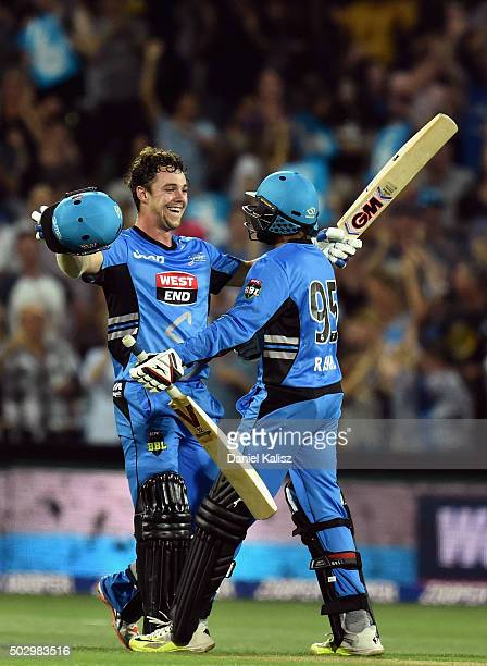 Travis Head of the Adelaide Strikers celebrates with Adil Rashid of the Adelaide Strikers after scoring his century and the winning runs during the...
