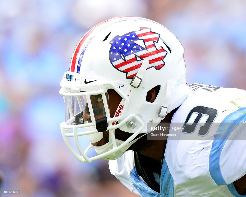 Travis Hughes #9 of the North Carolina Tar Heels wears a special flag-themed helmet for Military Appreciation Day against the East Carolina Pirates during play at Kenan Stadium on September 28, 2013 in Chapel Hill, North Carolina.