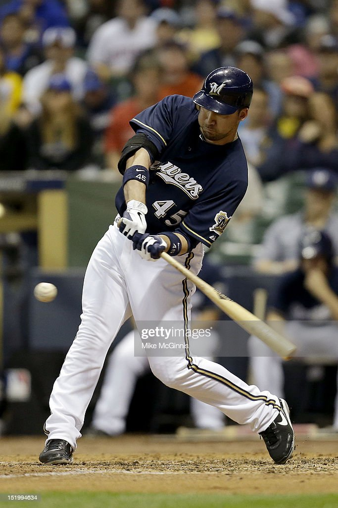 <a gi-track='captionPersonalityLinkClicked' href=/galleries/search?phrase=Travis+Ishikawa&family=editorial&specificpeople=551505 ng-click='$event.stopPropagation()'>Travis Ishikawa</a> #45 of the Milwaukee Brewers doubles, scoring Jonathan Lucroy in the bottom of the second inning against the New York Mets at Miller Park on September 14, 2012 in Milwaukee, Wisconsin.