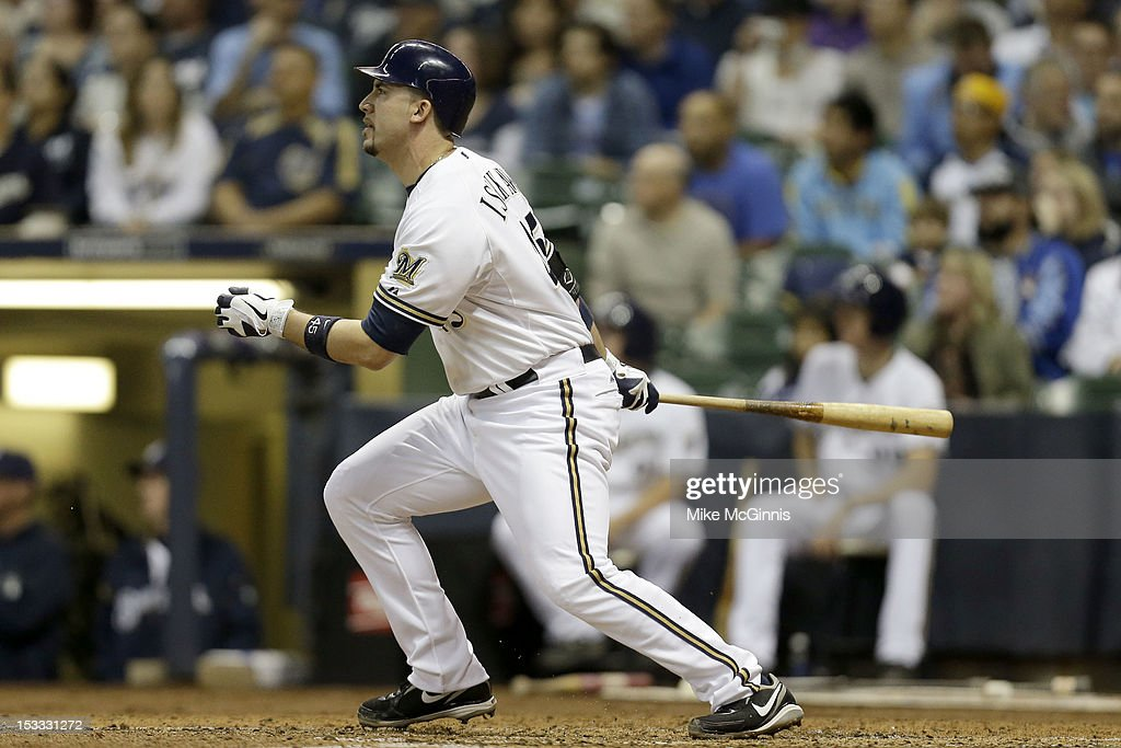 <a gi-track='captionPersonalityLinkClicked' href=/galleries/search?phrase=Travis+Ishikawa&family=editorial&specificpeople=551505 ng-click='$event.stopPropagation()'>Travis Ishikawa</a> #45 of the Milwaukee Brewers hits a bases clearing double scoring Ryan Braun, Jonathan Lucroy, Carlos Gomez in the bottom of the third inning against the San Diego Padres during the game at Miller Park on October 3, 2012 in Milwaukee, Wisconsin.