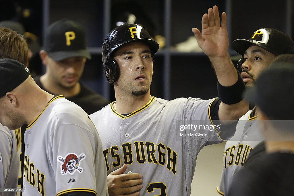 Travis Ishikawa #3 of the Pittsburgh Pirates celebrates in the dugout after reaching on a fielder choice in the top of the third inning against the Milwaukee Brewers at Miller Park on April 12, 2014 in Milwaukee, Wisconsin.