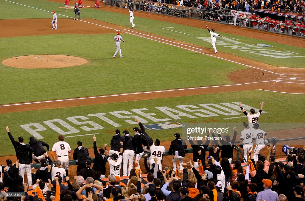 Travis Ishikawa #45 of the San Francisco Giants celebrates after he hits a three-run walk-off home run to defeat the St. Louis Cardinals 6-3 during Game Five of the National League Championship Series at AT&T Park on October 16, 2014 in San Francisco, California.