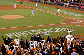 Travis Ishikawa of the San Francisco Giants celebrates after he hits a threerun walkoff home run to defeat the St Louis Cardinals 63 during Game Five...