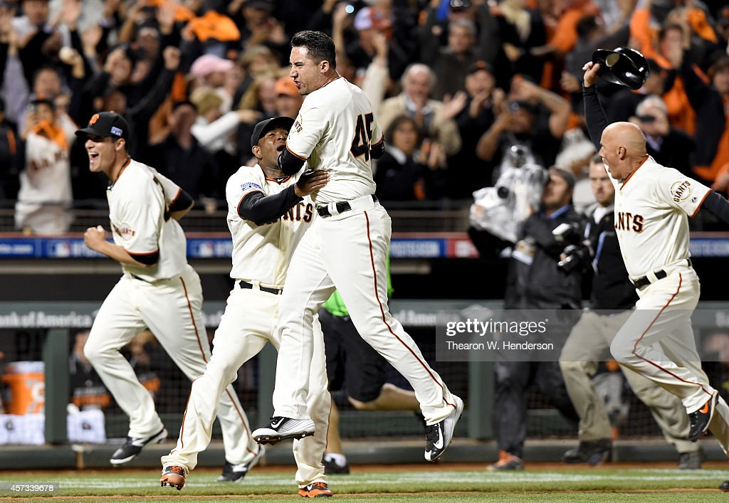 Travis Ishikawa of the San Francisco Giants celebrates with Santiago Casilla after Ishikawa hits a threerun walkoff home run to defeat the St Louis...