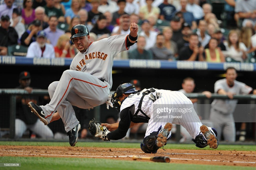 <a gi-track='captionPersonalityLinkClicked' href=/galleries/search?phrase=Travis+Ishikawa&family=editorial&specificpeople=551505 ng-click='$event.stopPropagation()'>Travis Ishikawa</a> #10 of the San Francisco Giants gets tagged out by <a gi-track='captionPersonalityLinkClicked' href=/galleries/search?phrase=Miguel+Olivo&family=editorial&specificpeople=209185 ng-click='$event.stopPropagation()'>Miguel Olivo</a> #21 of the Colorado Rockies during the game at Coors Field on August 3, 2010 in Denver, Colorado.