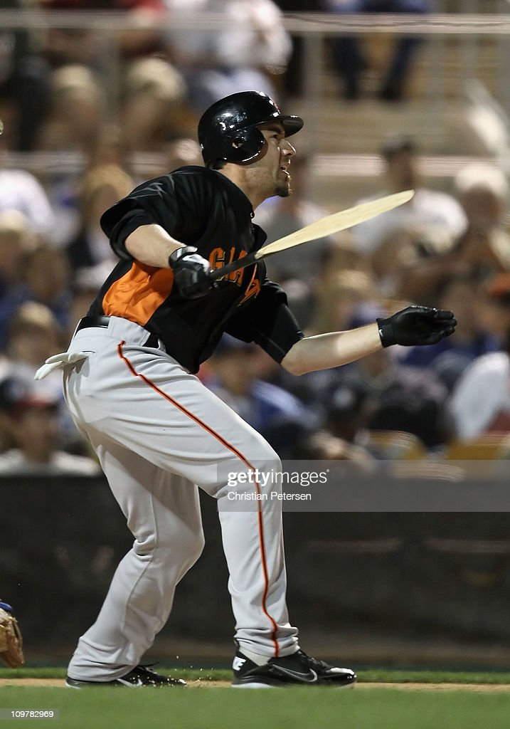 <a gi-track='captionPersonalityLinkClicked' href=/galleries/search?phrase=Travis+Ishikawa&family=editorial&specificpeople=551505 ng-click='$event.stopPropagation()'>Travis Ishikawa</a> #35 of the San Francisco Giants hits a RBI single against the Los Angeles Dodgers during the second inning of the spring training game at Camelback Ranch on March 4, 2011 in Glendale, Arizona.