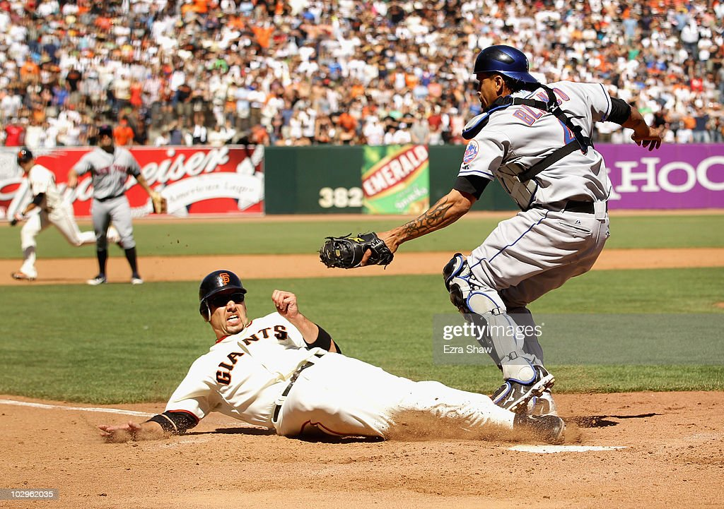 <a gi-track='captionPersonalityLinkClicked' href=/galleries/search?phrase=Travis+Ishikawa&family=editorial&specificpeople=551505 ng-click='$event.stopPropagation()'>Travis Ishikawa</a> #10 of the San Francisco Giants slides in to home plate under the tag of New York Mets catcher <a gi-track='captionPersonalityLinkClicked' href=/galleries/search?phrase=Henry+Blanco&family=editorial&specificpeople=211366 ng-click='$event.stopPropagation()'>Henry Blanco</a> #4 in the ninth inning AT&T Park on July 18, 2010 in San Francisco, California. Ishikawa was called out on the play and the Mets went on to win 4-3 in ten innings.