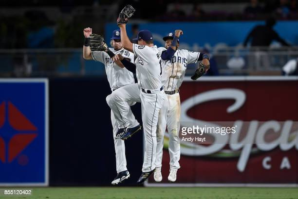 Travis Jankowski Hunter Renfroe and Manuel Margot of the San Diego Padres celebrate after the final out during the game against the Colorado Rockies...