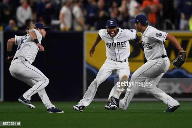 Travis Jankowski Manuel Margot and Hunter Renfroe of the San Diego Padres celelbrate after the game against the San Francisco Giants at Petco Park on...
