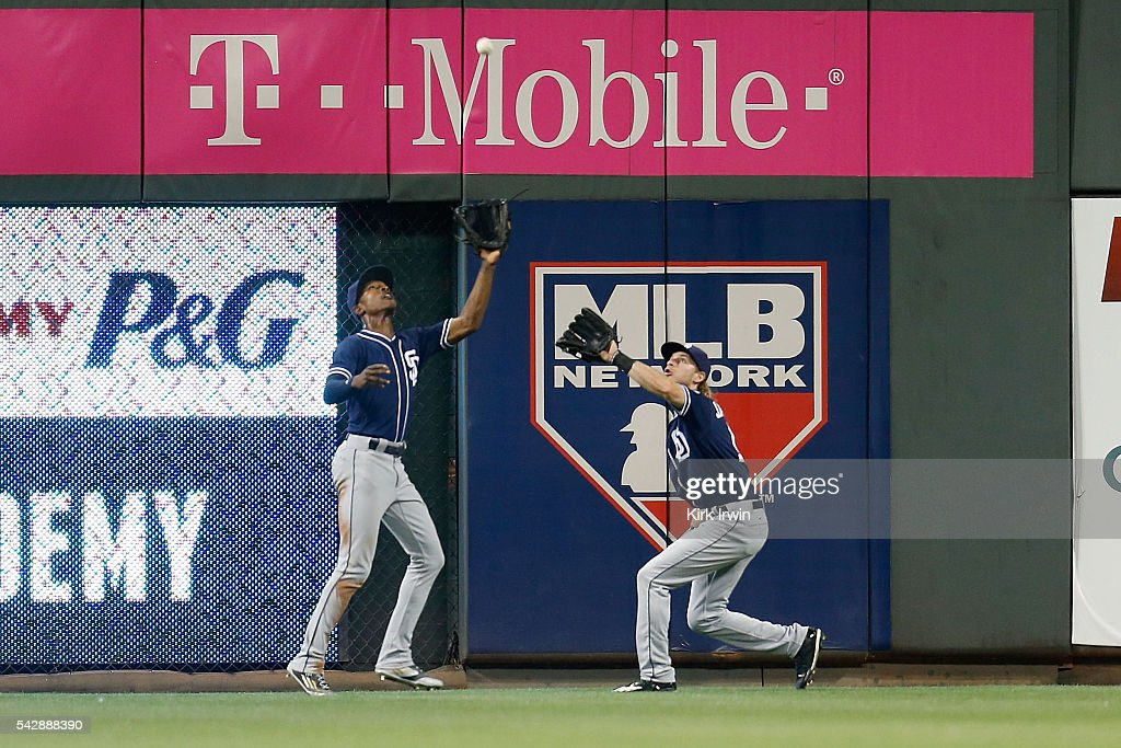 Travis Jankowski #16 of the San Diego Padres backs up Melvin Upton Jr. #2 of the San Diego Padres as he catches a fly ball hit by Jay Bruce #32 of the Cincinnati Reds in the seventh inning at Great American Ball Park on June 24, 2016 in Cincinnati, Ohio. San Diego defeated Cincinnati 13-4.
