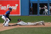Travis Jankowski of the San Diego Padres steals second base in the ninth inning during MLB game action as Devon Travis of the Toronto Blue Jays waits...