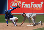 Travis Jankowski of the San Diego Padres steals second base in the ninth inning during MLB game action as Devon Travis of the Toronto Blue Jays...