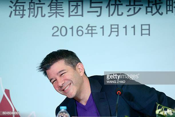 Travis Kalanick CEO of the global ridesharing service Uber smiles as he attends a press conference in Beijing on January 11 2016 Uber launched in...