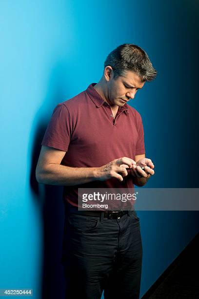 Travis Kalanick cofounder and chief executive officer of Uber Technologies Inc uses a mobile phone following a Bloomberg Television interview in Hong...