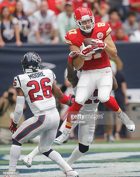 Travis Kelce of the Kansas City Chiefs catches a touchdown pass against Rahim Moore of the Houston Texans in the first quarter in a NFL game on...