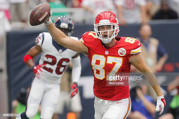 Travis Kelce of the Kansas City Chiefs celebrates after catching a touchdown pass against Rahim Moore of the Houston Texans in the first quarter in a...