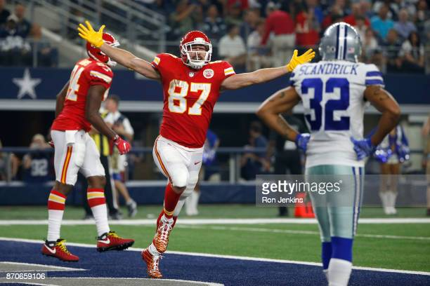 Travis Kelce of the Kansas City Chiefs celebrates the third quarter touchdown against the Dallas Cowboys in a football game at ATT Stadium on...