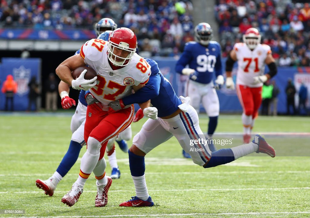 Travis Kelce #87 of the Kansas City Chiefs is hit by Darian Thompson #27 of the New York Giants after a catch during their game at MetLife Stadium on November 19, 2017 in East Rutherford, New Jersey.