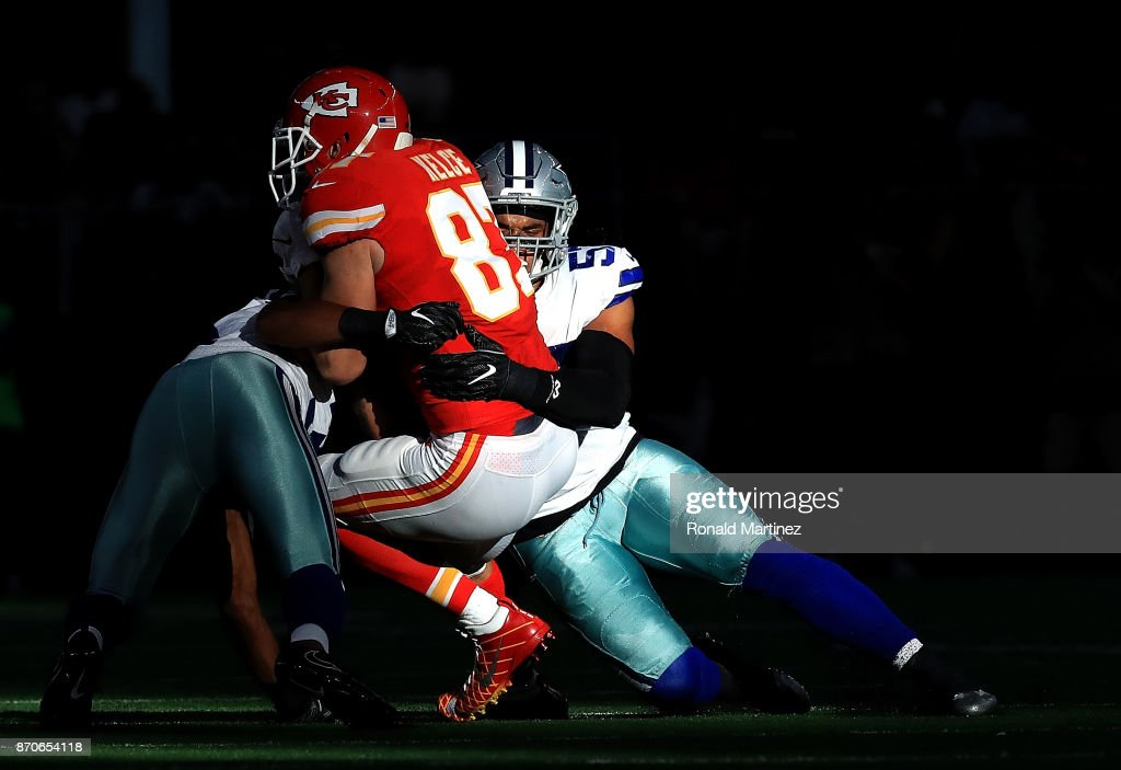 Travis Kelce #87 of the Kansas City Chiefs is tackeld by Damien Wilson #57 of the Dallas Cowboys in the second quarter at AT&T Stadium on November 5, 2017 in Arlington, Texas.