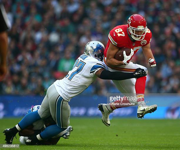 Travis Kelce of the Kansas City Chiefs is tackled by Glover Quin of the Detroit Lions defence during the NFL match between Kansas City Chiefs and...