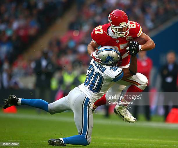 Travis Kelce of the Kansas City Chiefs is tackled by Josh Wilson of the Detroit Lions during the NFL match at Wembley Stadium on November 01 2015 in...