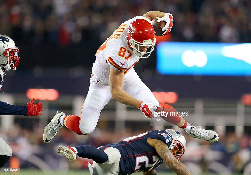<a gi-track='captionPersonalityLinkClicked' href=/galleries/search?phrase=Travis+Kelce&family=editorial&specificpeople=6237659 ng-click='$event.stopPropagation()'>Travis Kelce</a> #87 of the Kansas City Chiefs jumps over <a gi-track='captionPersonalityLinkClicked' href=/galleries/search?phrase=Patrick+Chung&family=editorial&specificpeople=2242933 ng-click='$event.stopPropagation()'>Patrick Chung</a> #23 of the New England Patriots in the first half during the AFC Divisional Playoff Game at Gillette Stadium on January 16, 2016 in Foxboro, Massachusetts.