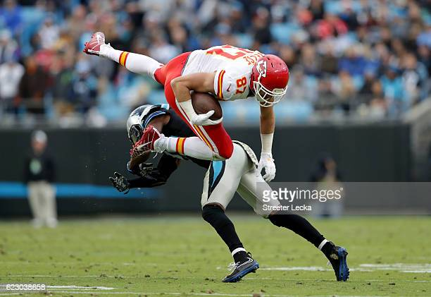Travis Kelce of the Kansas City Chiefs runs the ball against Daryl Worley of the Carolina Panthers in the 3rd quarter during their game at Bank of...