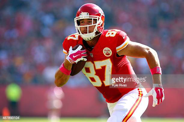 Travis Kelce of the Kansas City Chiefs runs the ball against the St Louis Rams during the first half at Arrowhead Stadium on October 26 2014 in...