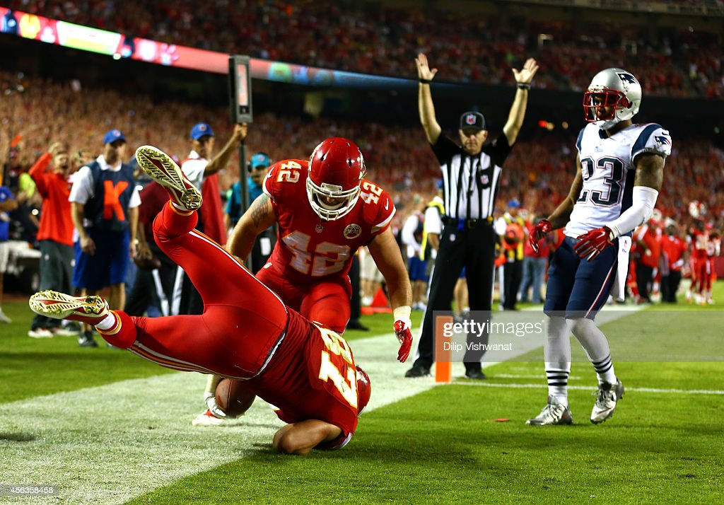 <a gi-track='captionPersonalityLinkClicked' href=/galleries/search?phrase=Travis+Kelce&family=editorial&specificpeople=6237659 ng-click='$event.stopPropagation()'>Travis Kelce</a> #87 of the Kansas City Chiefs scores a touchdown as <a gi-track='captionPersonalityLinkClicked' href=/galleries/search?phrase=Patrick+Chung&family=editorial&specificpeople=2242933 ng-click='$event.stopPropagation()'>Patrick Chung</a> #23 of the New England Patriots defends during the second half at Arrowhead Stadium on September 29, 2014 in Kansas City, Missouri.