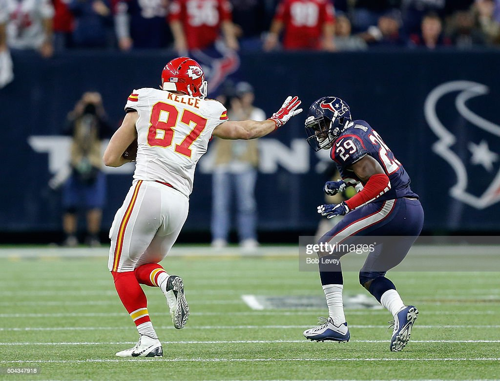 Travis Kelce #87 of the Kansas City Chiefs stiff arms Andre Hal #29 of the Houston Texans during the AFC Wild Card Playoff game at NRG Stadium on January 9, 2016 in Houston, Texas.
