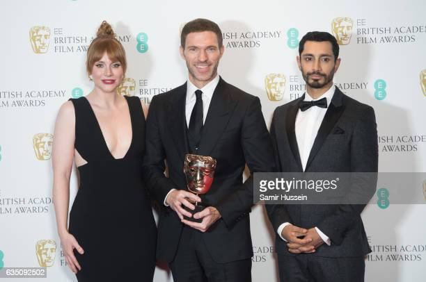 Travis Knight poses with his award for Animated Film Award with Bryce Dallas Howard and Riz Ahmed poses in the winners room at the 70th EE British...