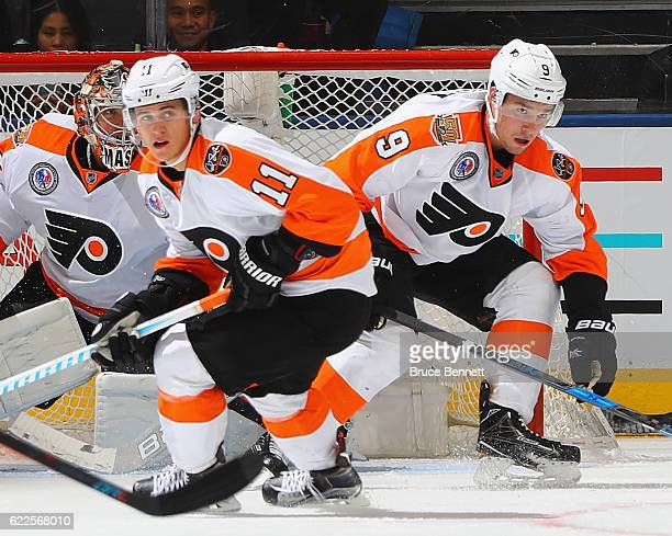 Travis Konecny and Ivan Provorov of the Philadelphia Flyers skates against the Toronto Maple Leafs at the Air Canada Centre on November 11 2016 in...