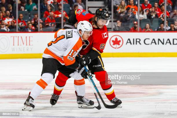 Travis Konecny of the Philadelphia Flyers and Jaromir Jagr of the Calgary Flames battle for position in a game against the Philadelphia Flyers at the...