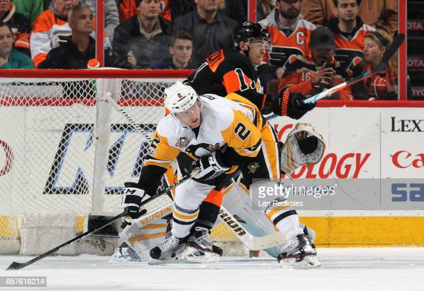 Travis Konecny of the Philadelphia Flyers battles in the crease against Chad Ruhwedel of the Pittsburgh Penguins on March 15 2017 at the Wells Fargo...