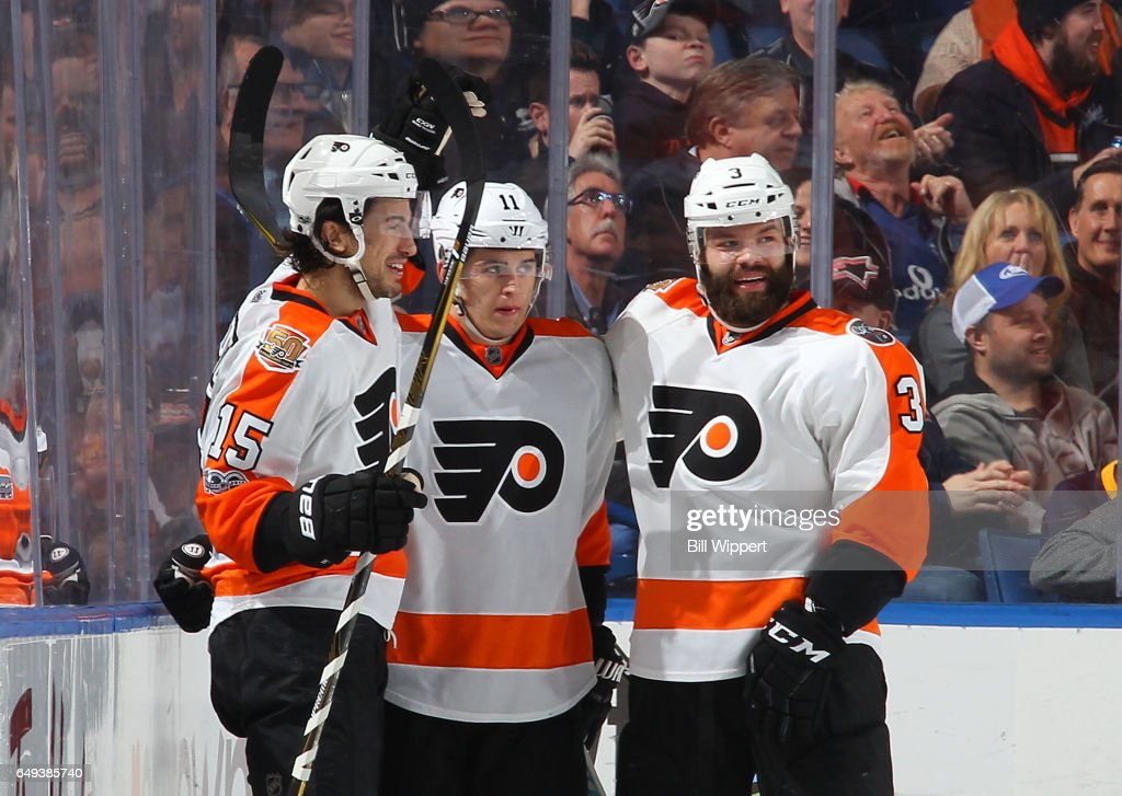 Travis Konecny #11 of the Philadelphia Flyers celebrates his third period goal with Michael Del Zotto #15 and Radko Gudas #3 during an NHL game against the Buffalo Sabres at the KeyBank Center on March 7, 2017 in Buffalo, New York. The Flyers won, 6-3.