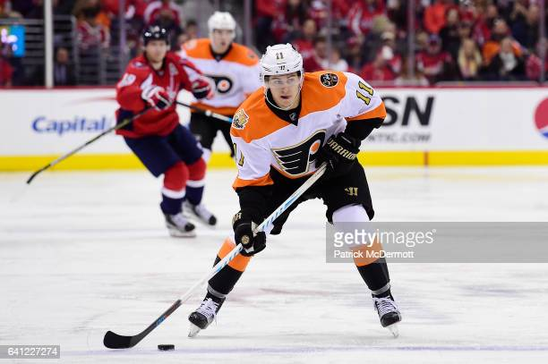 Travis Konecny of the Philadelphia Flyers controls the puck against the Washington Capitals in the second period during an NHL game at Verizon Center...